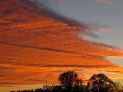 Color reflections article showing view of clouds in the sky at sunset